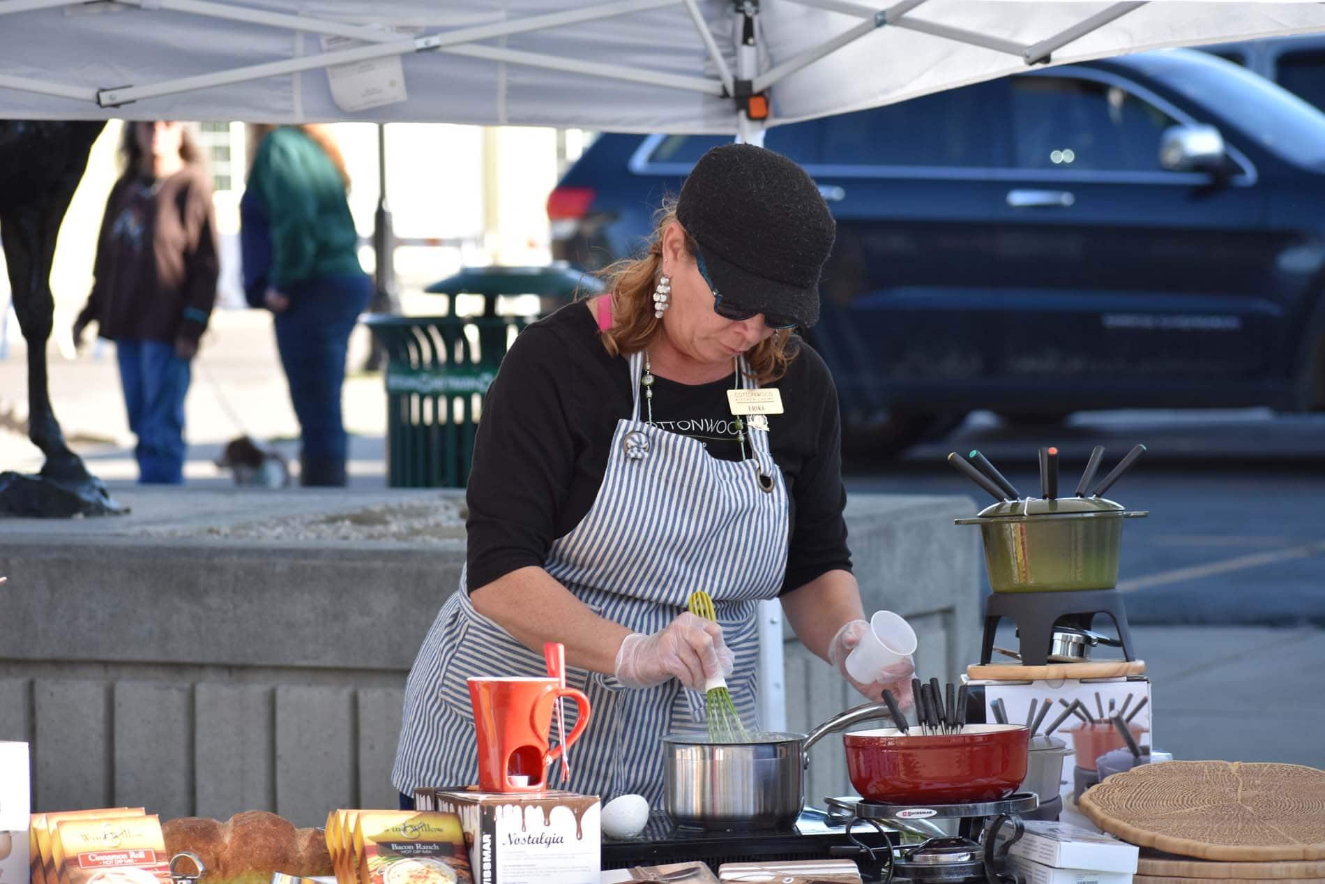 Photo of woman conducting cooking demonstration at Sheridan Farmers Market